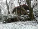 Cabin in the snow- Cuddle by the fire and watch it snow.