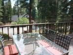 lovely front deck with OW Lee patio set and peak of the lake