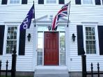 Front door where the British Union Jack and National flag of Haudenosaunee