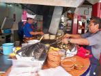 Chefs barbeque chicken at La Fogata restaurant