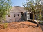 Private carport surrounded by African Bush