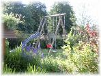 The garden with its climbing frame, swings, slide and sand pit