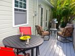 Comfortable Deck Area Seating in the Back of Home with Grill