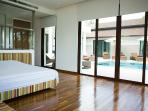 Bedroom 2 with pool and sea view