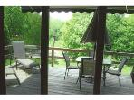 Fully furnished deck with electric awning