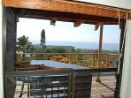 Bar on lanai, view from a living room window.