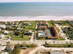 Aerial view of home's proximity to beach.  See white arrow for home location.