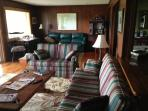 Four sofas plus chairs and Dish TV in family room