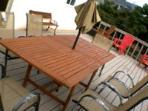 Large deck with BBQ and table and chairs