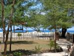 Bungalow's white sand path to the beach