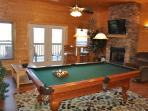 Pool Table with fireplace outside covered porch