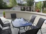 Sheltered Patio with outdoor loudspeakers, heaters and large gas Barbeque