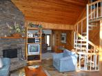 Large cozy family room with real Ozark stone wood-burning fireplace & extended open living room area