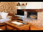 the lounge has rustic features including an cozy open fireplace and juniper beamed ceiling