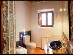 The Ibicencan bathroom with bidet, shower and toilet