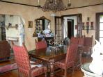 Formal dining room with high ceiling