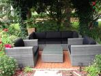 Stylish and comfortable shaded backyard lounge seating