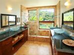 Master bathroom, glass sinks, blk granite counter tops, natural stone tub shower