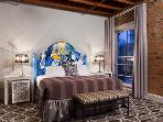 The one bedroom villas are local artist designed. This one will brighten your day!