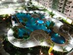 night view of the swimming pool in the condo