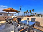 Rooftop patio with ocean view, grill, lots of space for dining and entertaining