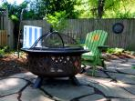 Peaceful shady garden retreat with fire pit