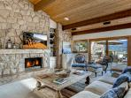 The exposed beam, wood ceiling and stone wall typify California modern design and create a spacious living space with...