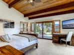 Master bedroom #1 has a king bed, en-suite bath, large flatscreen TV, walk-in closet, and amazing views.