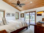 Master bedroom #3 has a queen bed, sliding doors leading out to the patio and hot tub area, ceiling fan, and TV.
