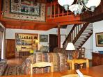 Gracious living area has fine art, lots of wood