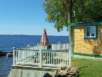 #109 Moosehead Lake cottage with a deck literally `on the water`