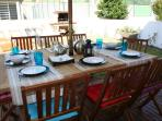 Outside dining in private deck and garden with barbecue