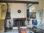 Living Room with open fire place & sat TV