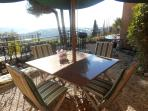 Out door  BBQ & dining area next to kitchen with view over the Riviera