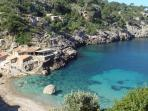 Cala Deia showing the beach restaurant ideal for fresh fish lunches looking out to sea