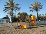 Take the children to the play area on the beach