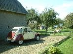 Betty our CV2 at the cottage with the main house across the orchard