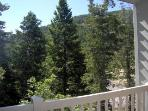 VIEW FROM UPSTAIRS TERRACE.