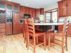 Kitchen has everything you'll need. Includes large island with three stools