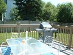 Private, fenced back yard with deck off kitchen. Outdoor shower to right.