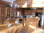 Dining room and kitchen facilitates family gatherings overlooking the Schuss Mountain ski hill