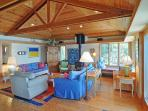 The living room features vaulted ceilings, windowseats, and a wood stove.
