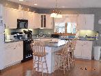 Kitchen with breakfast bar seats 4