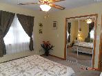 Master bedroom with full length mirrors on sliding closed doors