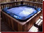 Full size hot tub on back deck