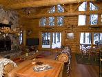 Great room, has real stone fireplace, comes with lots of wood for burning, and 50' plasma TV!