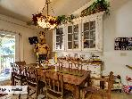 Gather around the farm house table to enjoy the family and talk about all the fun you are having!