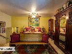 Master bedroom with queen bed,  flat screen TV, Blu-Ray & NetFlix!  Also a view of pool & flowers