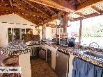 Whose doing the grilling?  Outdoor kitchen includes burners, microwave and small warming oven!