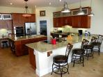 The spacious kitchen is open to the living and dining areas, is great for entertaining and has breakfast bar seating.